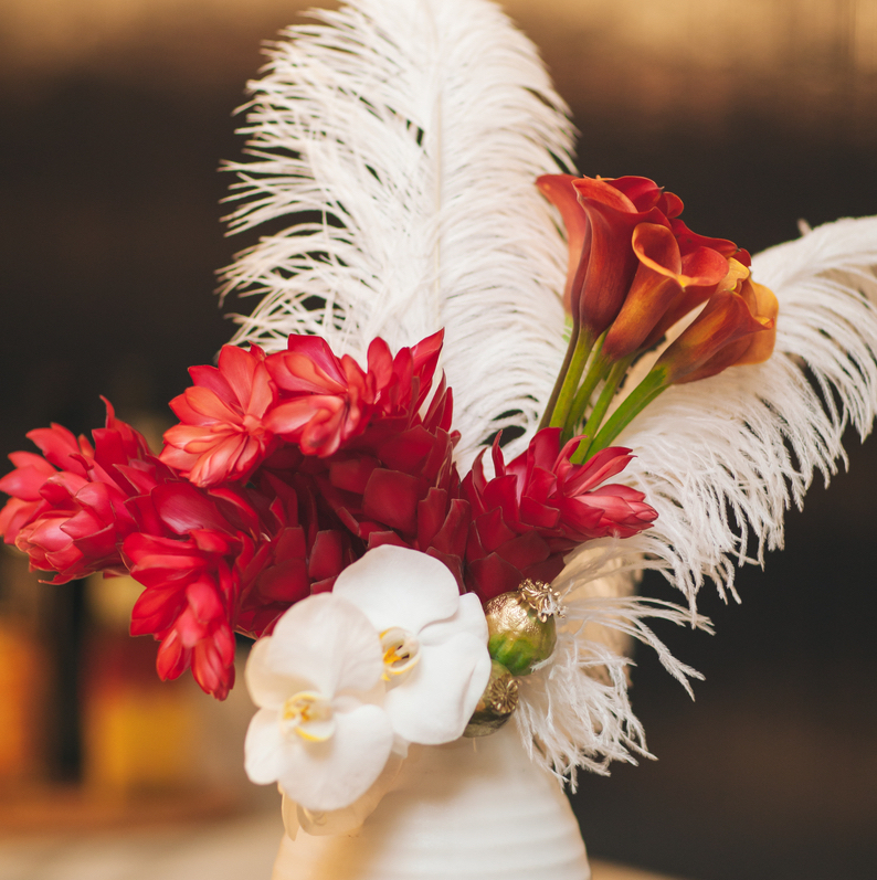 unique flower arrangement with feathers Tenfold Style